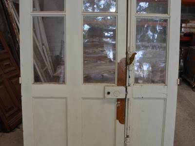 Porte vitrée en chêne à 2 vantaux.